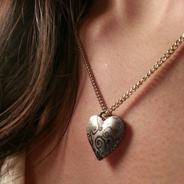 Titanium heart pendant. Welded together and detailed with the laser welder.