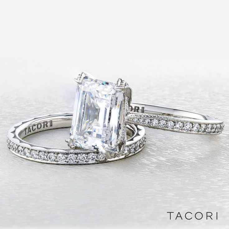 All eyes will be on your center diamond, in this not so simple solitaire emerald cut diamond engagement ring. A sleek band with pavé set diamonds brings your brilliant emerald cut diamond to life, making it worthy of your love. RoyalT HT2626EC10X8