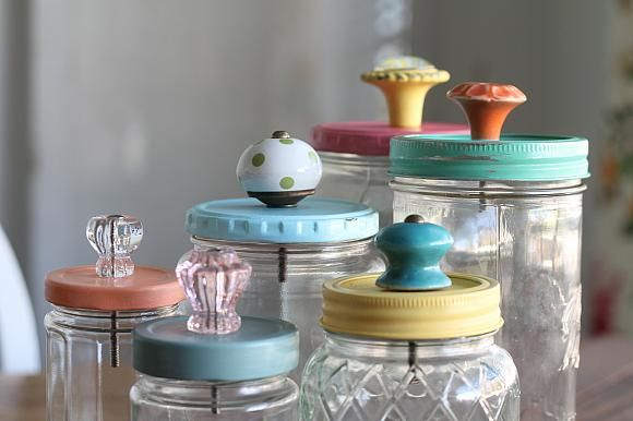 Don't toss those empty jars! Paint the lids and add a knob for easy storage!
