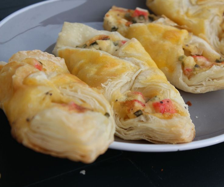 This is very simple and very delicious dish. It needs several minutes to prepare.Ingredients:6 oz. cream cheese, softened 1/2 cup mayonnaise 14 crab stick 4 green onions 16 oz. tube crescent roll dough salt and pepper, to taste1 egg yolk