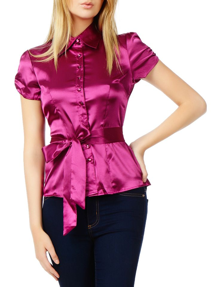 This short sleeve satin blouse with waist tie is lightweight with little stretch for comfort. Its shiny, satin-like material makes this shirt stand out. It features cap sleeves with waist tie for a fe
