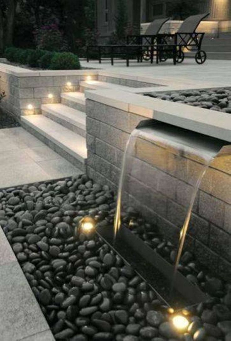 Lawn & Garden:Modern Backyard Waterfall Decor With Gravel And Modern Concrete Stair Also Contemporary Lounge Chair Make a Relaxed Backyar… | Water features in the garden, Modern landscaping, Modern garden design