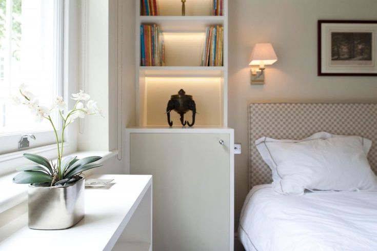 Bedroom in Gardens House with White Side Table and a Planter with White Duvet…