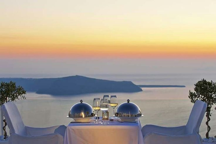 Perfect view, perfect colours, perfect symmetry, perfection tailor-made for you! (See more at http://www.gastronomysantorini.com and http://www.candlelightdinnersantorini.com)