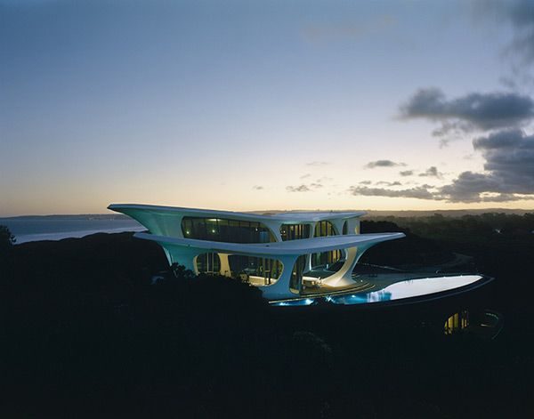 Impressive futuristic home on South Africa's Southern Coast on the Indian Ocean in Keurboomstrand, a little resort town in the province Western Cape which is mostly bound by the Atlantic Ocean giving it the notorious age-old Cape of Storms reputation. It's the holiday home of British entrepreneur who built for his wife.