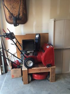 """The """"Mower/Blower Double Stacker""""! A good way to save some floor space in the garage, since I use my Snow Blower less than my mower I put it on top. It rolls up nicely with my ramps."""