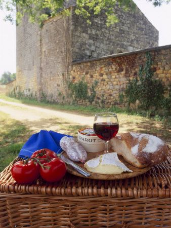 Picnic Lunch of Bread, Cheese, Tomatoes and Red Wine on a Hamper... Dordogne, France    by Michael Busselle