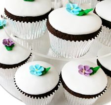 2 cups - Domino® Confectioners Sugar  1 1/2 tablespoons - meringue powder  3 tablespoons - warm water  Assorted food coloring