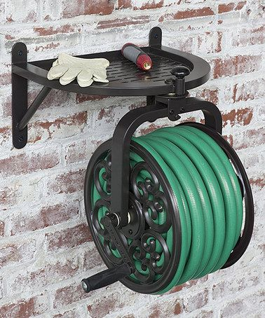 Navigator Rotating Hose Reel With a traditional design and durable construction, this hose reel keeps the garden organized in style.   Holds garden hose up to 125' L 20.1'' W x 24'' H x 17.7'' D Steel Imported  Garden hose gardening backyard decor yard hose hanger
