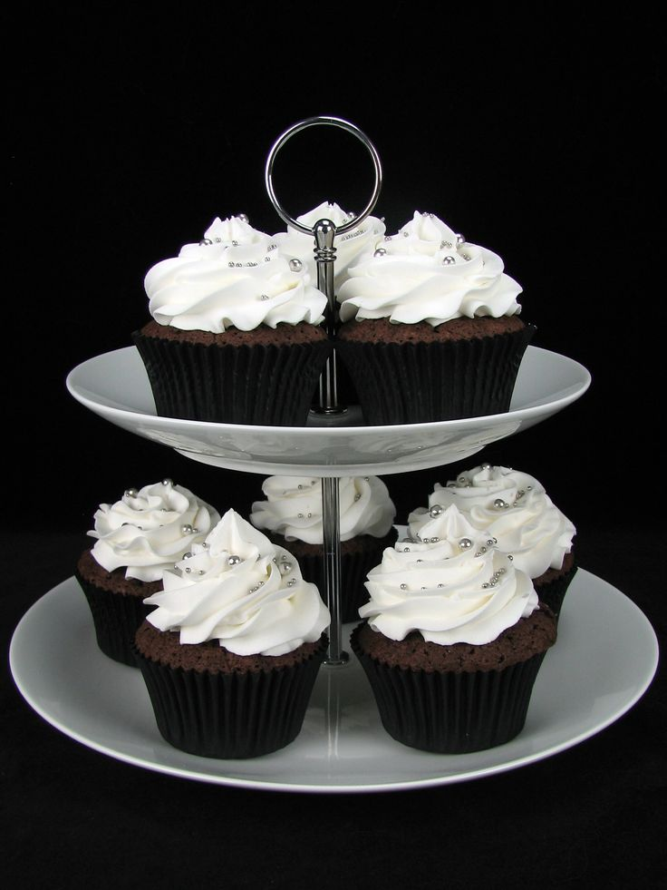 Chocolate mud cake cupcakes with white buttercream and silver sprinkles.