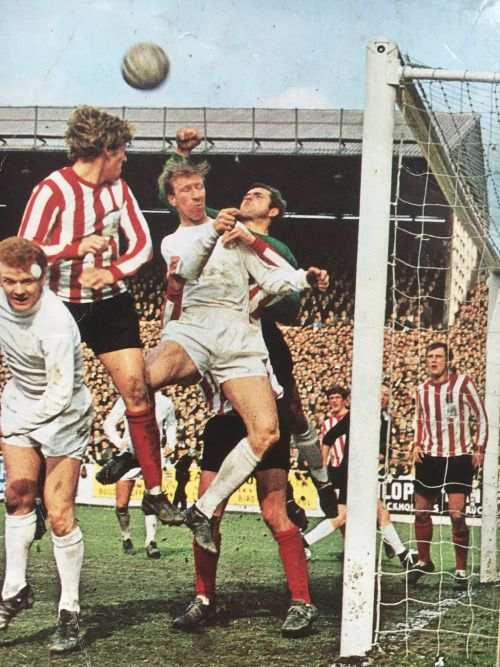 11th November 1967. Sheffield United Alan Hodgkinson punches clear under pressure from Jack Charlton and Billy Bremner