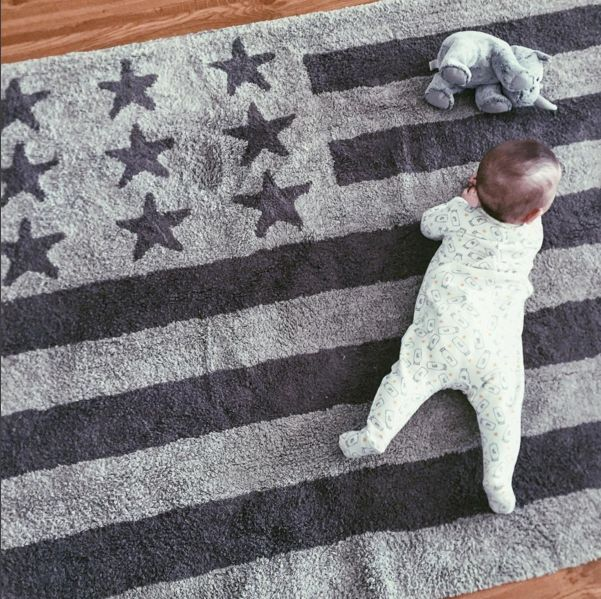 Our grey American Flag rug is chic and practical. Our rugs are 100% cotton and machine washable, perfect for nursery decor, kids play rooms and family-friendly home decor. All of our rugs are anti-allergen and responsibly made in India. Visit lorenacanals.com for more information on our stylish children's rugs and to shop.