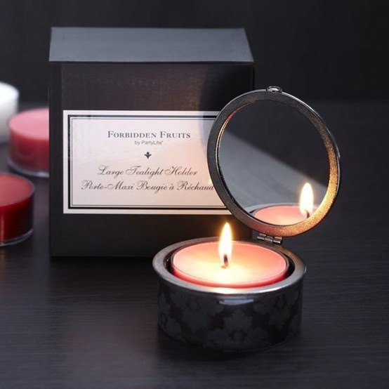 Partylite Forbidden Fruits Mirrored tealight holder.. Just bought this for my bedroom!