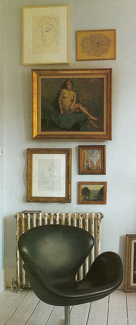 old world art wall with mid century chair