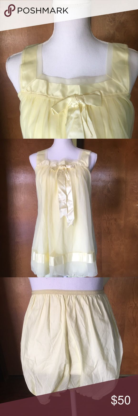 """Vintage Two Piece Lingerie Sleep Teddy Bloomers Unbelievable two piece vintage lingerie bed set. Pale yellow color with a silly bow on the top. High waisted matching bloomer style pants to go underneath. Just about 19"""" pit to pit. This set is tagged a size medium, but may also work as a looser look for a size small. Wear together or alone. Treat yourself to something extra special! Like new condition, no flaws to note b Vintage Intimates & Sleepwear Chemises & Slips"""
