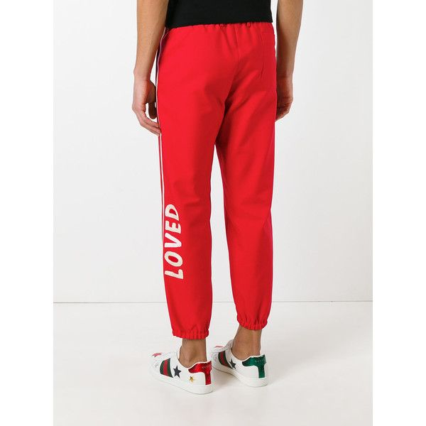 Gucci Loved logo trousers ($1,150) ❤ liked on Polyvore featuring men's fashion, men's clothing, men's pants, men's casual pants, mens white pants, mens elastic cuff pants, mens polyester pants, mens striped pants and mens loose fit cargo pants