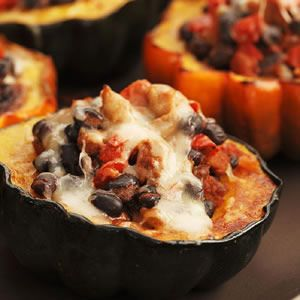 Cumin and chili powder season a filling of turkey sausage, tomatoes, black beans and Swiss cheese for creamy acorn squash. Serve this stuffed squash with warmed corn tortillas for wrapping up bites of all the tasty ingredients.