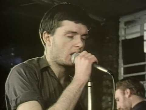 """Ian Curtis in the music video for the seminal classic by Joy Division ~ """"Love Will Tear Us Apart."""" On this day in 1980 he took his life. Let's remember and honor in this #MentalHealthAwarenessMonth…"""