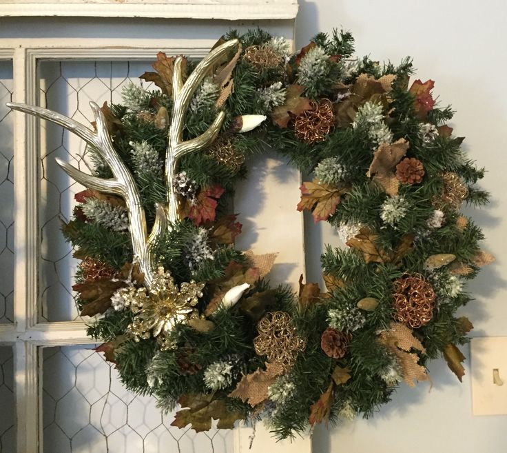 Golden faux deer antlers on an evergreen wreath surrounded by frosted pine cones, burlap leaves, fall colored leaves and just hints of sparkle through out to bring this wreath together. Lights can be added as shown in last picture for an extra 15.00. Just message me if you would like the lights added and I will do a custom listing for you.