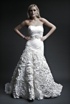 I love the rosettes on the skirt.  Beautiful texture on this wedding gown.  http://yourbridesmaid.wordpress.com/