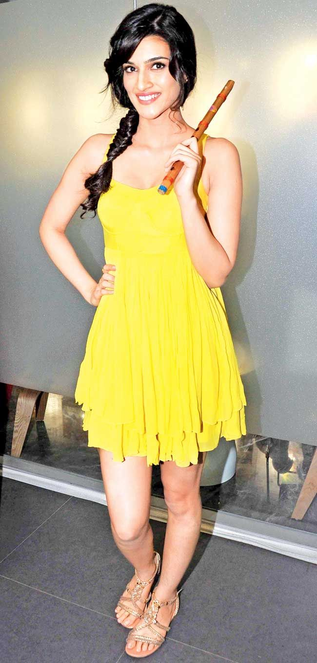 Kriti Sanon in a bright yellow dress at the launch of the first song of her film 'Heropanti' titled 'Whistle Baja'. #Style #Bollywood #Fashion #Beauty