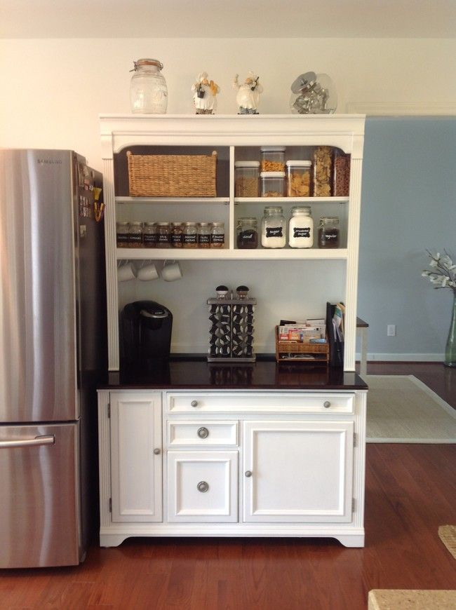 Old wooden hutch finds new life with a white paint makeover