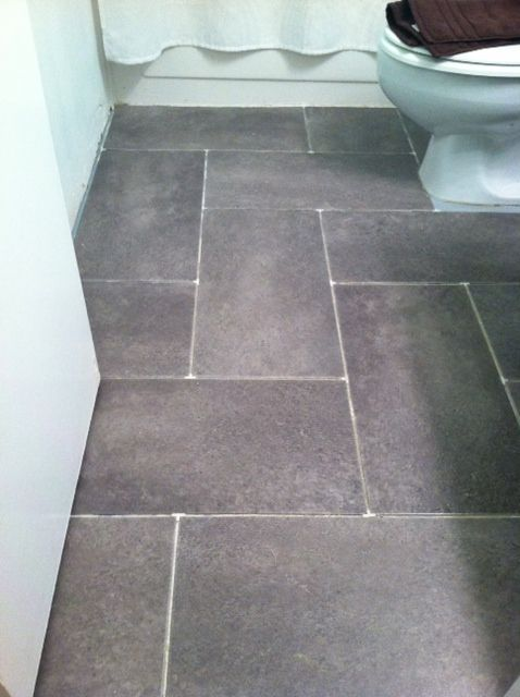 The cabindo a clean slate floor remodeling pinterest herringbone wells and bathroom for Groutable vinyl tile in bathroom