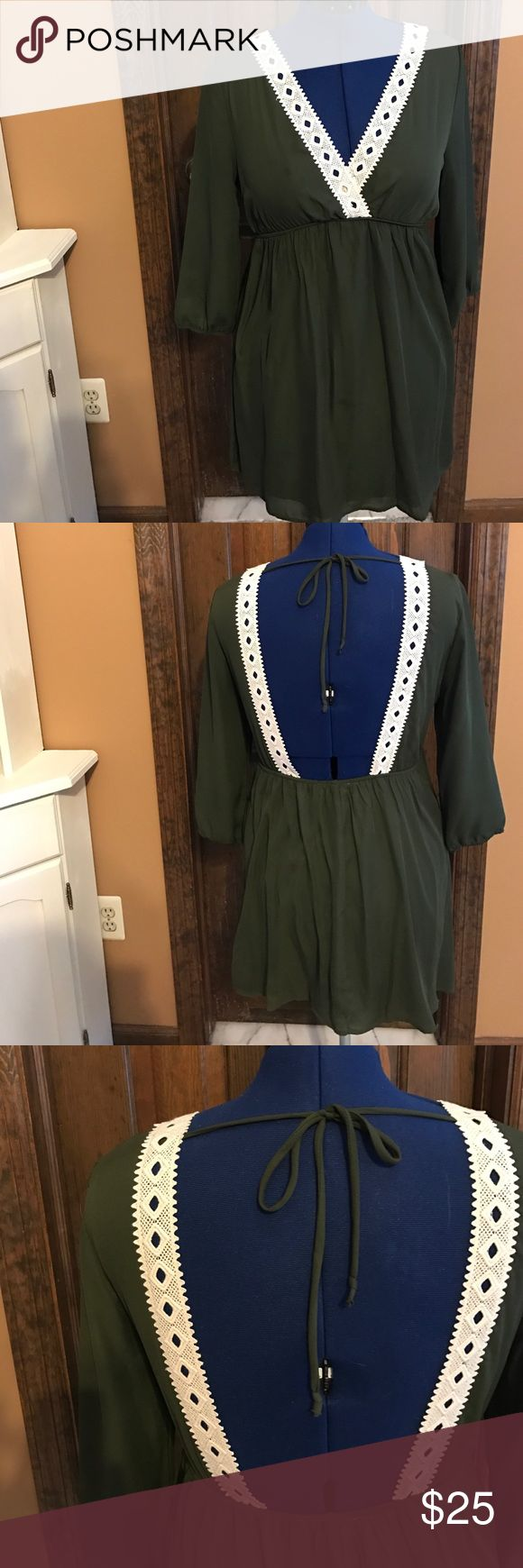 NWOT Olive and cream mini dress lace detail Olive mini dress with open back, v neck front, tie in back and empire waist. So adorable for summer with tan sandals or with a leather jacket, tights and boots in the fall! Boutique Dresses Mini