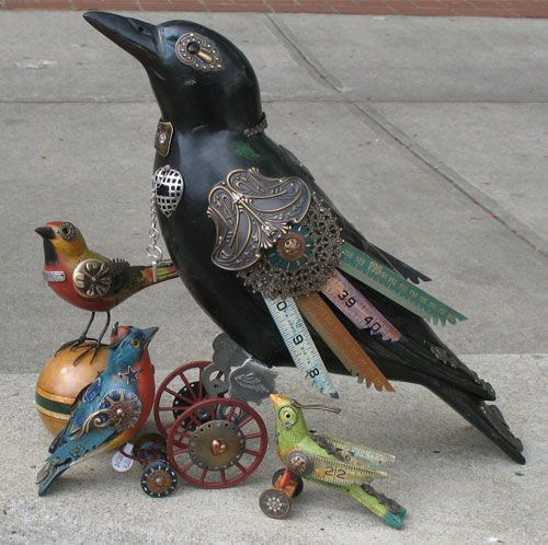 Artist Jim Mullan took vintage hunting decoys shaped like crows and small birds and turned them into bird sculptures!