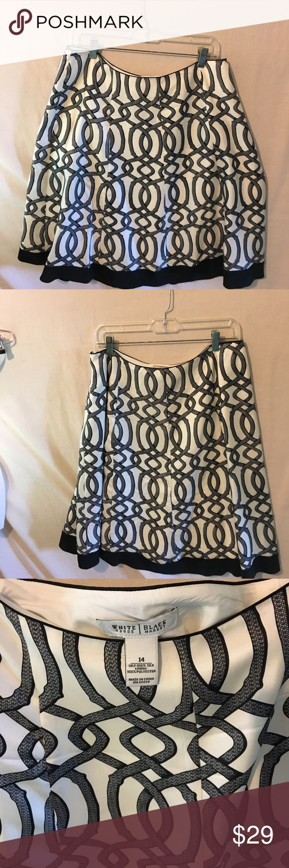 White House Black Market, size 14 silk skirt Lovely white with black link designs 100% silk skirt, size 14.  EUC, very flattering; pair with red heels 👠 for a standout look! White House Black Market Skirts Midi