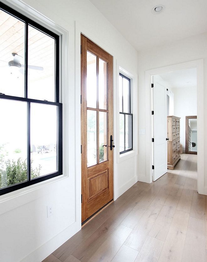Black Windows Building A House Is All About Saving Money Where You Can To Get Our Windows Pre Finished In Black On T Interior Windows Home Wood Doors Interior