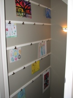 another idea to hang art, think we might do a row or two in the kid's room, but we have the perfect space in the playroom