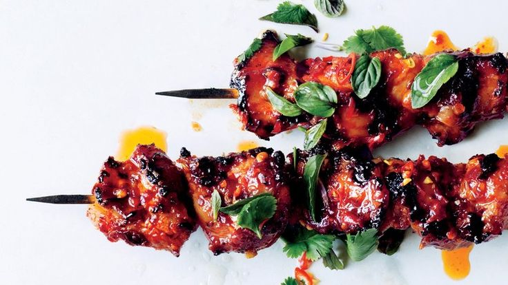 Sambal Chicken Skewers Recipe | Bon Appetit ~ Asian style grilled chicken kebabs with a spicy, sticky glaze of brown sugar, rice vinegar, fish sauce (or soy sauce), sambal oelek, & ginger. *Add garlic.