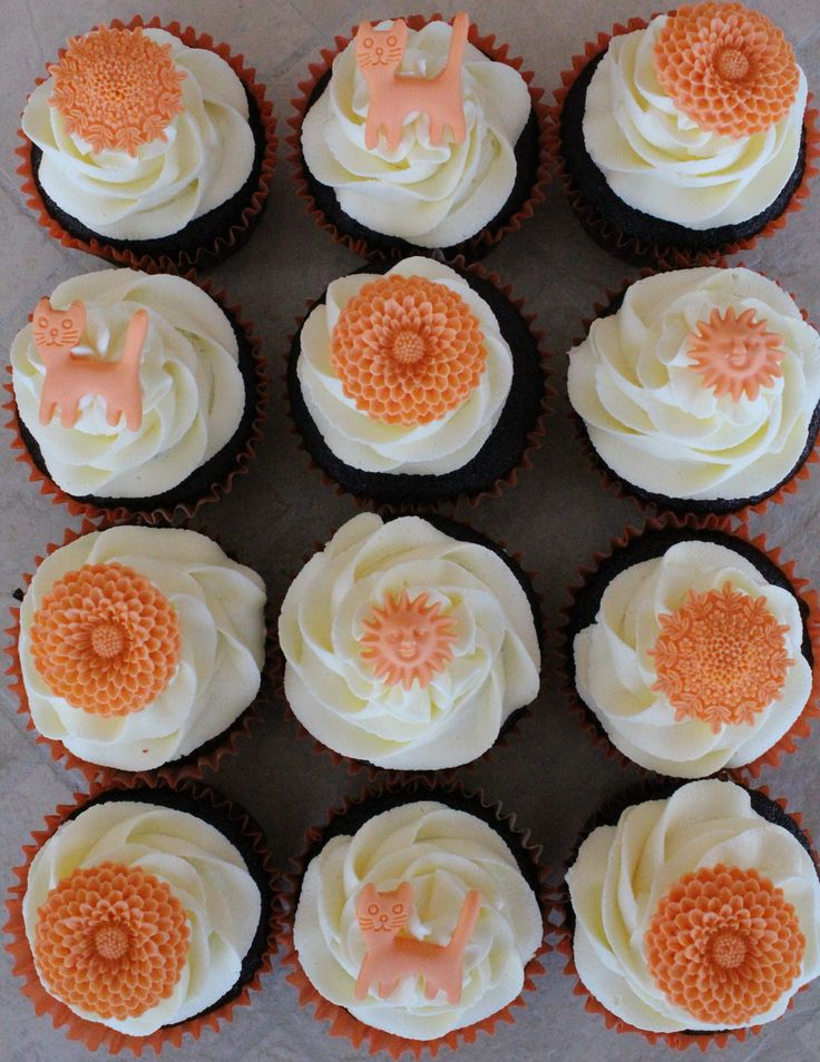 Orange flowers and cats on chocolate cupcakes