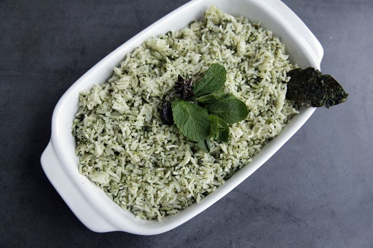 Pulao is moreish, fluffy aromatic rice spiked with subtle whole spices. This version with chopped spinach is versatile enough to add interest as part of an extravagant feast or a meal-in-one served with not much more than a dollop of yoghurt and spoon of pickle.