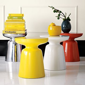 """A west elm icon. As crisp and cool as a cocktail glass, the cast-metal Martini Side Table comes in a range of bright colors or polished aluminum. Bonus: This ultra-versatile best-seller triples as a seat, a side table and a coffee table when grouped in twos and threes.    • Recyclable aluminum.  • 15""""diam. x 16.5""""h.  West Elm  $129"""