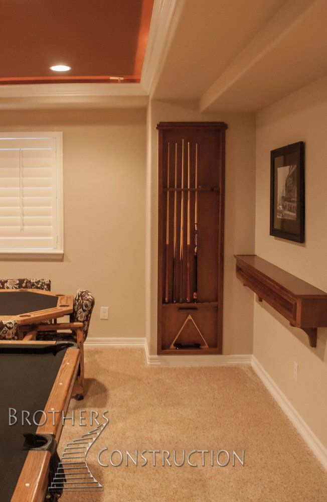 custom, cherry pool cue rack and drink rail in basement finishing project in North Denver #PoolTable #DrinkRail #cherry