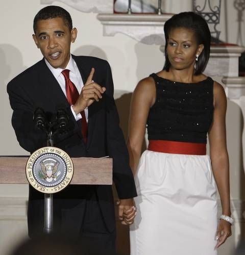 President Barack Obama, with his wife Michelle Obama, speaks during a reception for ambassadors in the Grand Foyer at The White House in Washington, Monday, July 27, 2009.