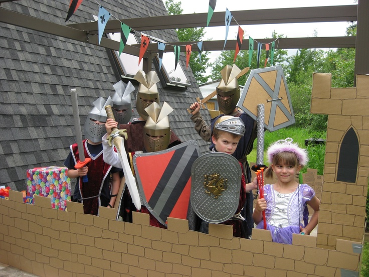 Home-made shields (just poster paper and duct tape on heavy-duty corrugated cardboard), dollar store foam swords, a cardboard castle, and awesome paper helmets made from a template from the Cleveland Museum of Art