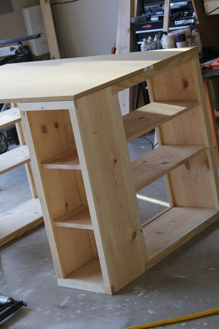 DIY bookshelf desk / craft table. Made from the 'MODERN CARFT TABLE' plan at http://ana-white.com/2010/09/modern-craft-table (Try this one which is similar: http://ana-white.com/2010/02/plans-bedford-project-table-top-with.html )