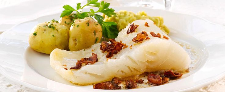 Lutefisk - Stockfish softened in water and lye, then cooked and sometimes grilled. Typical accompaniments are potatoes, bacon, mushy peas and mustard. Although the wobbly fish is traditionally the centre of Christmastime feasts, the season is getting longer as the dish enjoys greater popularity.