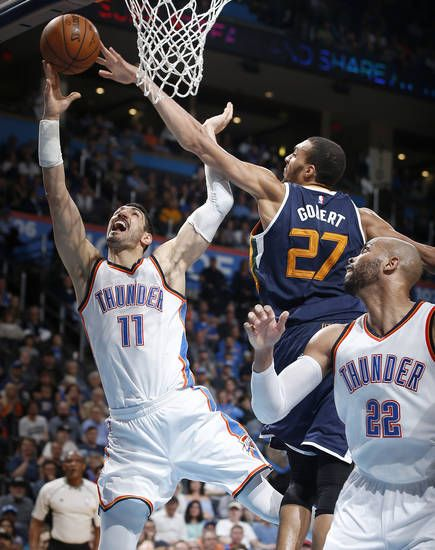 Oklahoma City's Enes Kanter (11) goes to the basket past Utah's Rudy Gobert (27) during an NBA basketball game between the Oklahoma City Thunder and the Utah Jazz at Chesapeake Energy Arena in Oklahoma City, Tuesday, Feb. 28, 2017. Photo by Bryan Terry, The Oklahoman