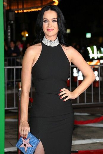 "Katy Perry arrived to the ""Office Christmas Party"" premiere wearing a sexy black Cinq à Sept dress, adorned with pearls on the neck"
