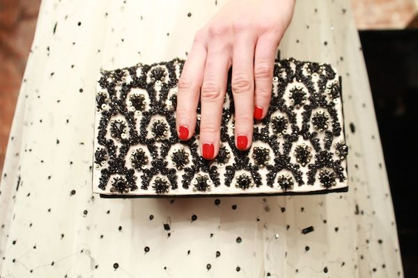 a pretty black and white clutch + red nails