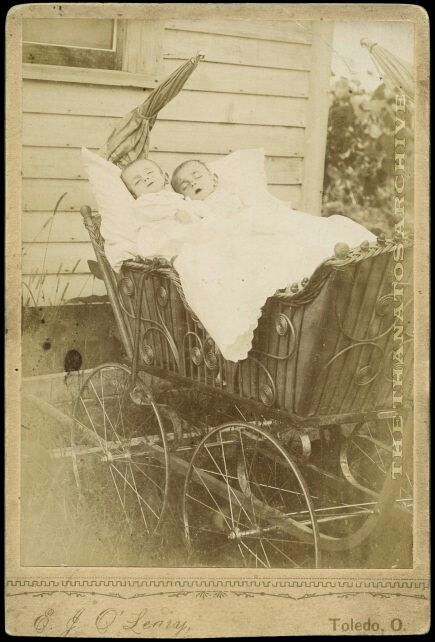 baby carriage, with postmortem babies, possibly twin's...