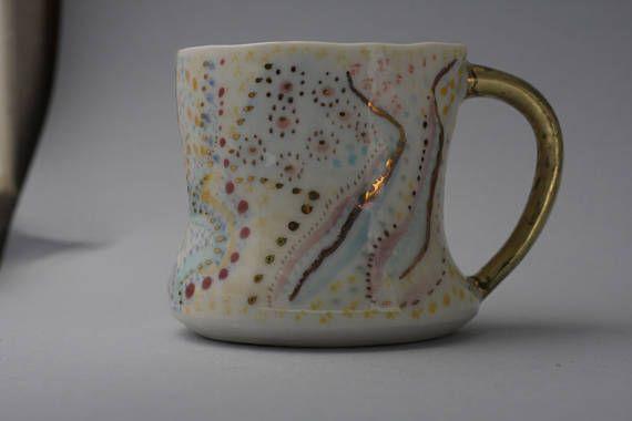 Porcelain wheel thrown-hand painted mug aprox 8oz. With 23k