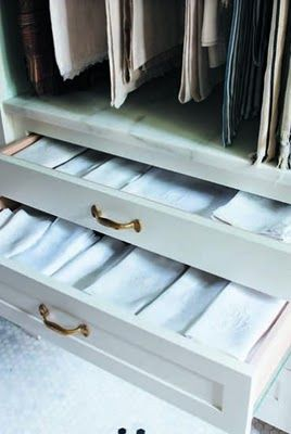 Butler's pantry drawers for linen storage with  an area above to hang tablecloths.  A perfect way to store linens to keep them crisp and fresh.