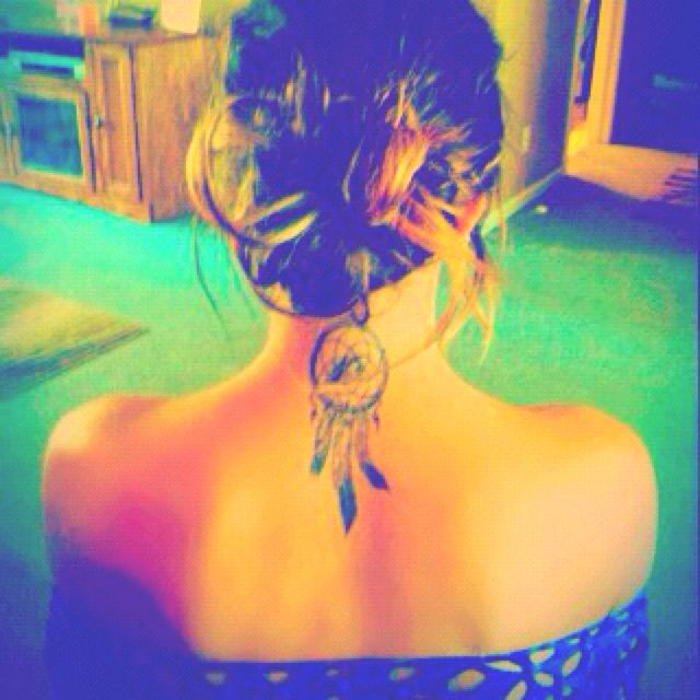 dreamcatcher tattoo. more between the shoulder blades, but essentially ideal
