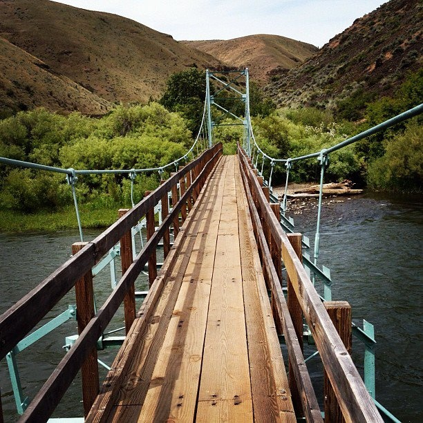 walk and swing on this bridge that leads to a hidden wonderland in Umptanum canyon near ellensburg, wa
