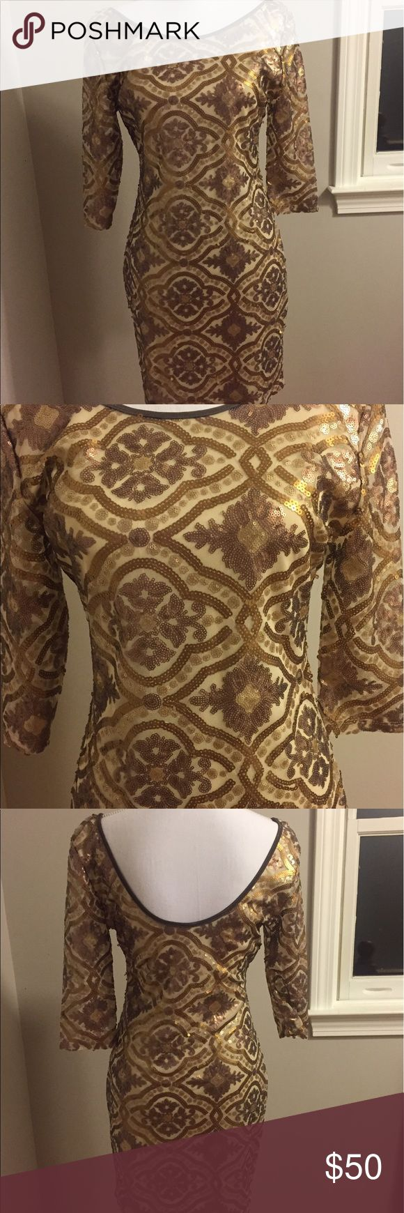 Lulus gold sequin dress size L Lulus gold sequin dress size l. Low back, beautiful pattern. Never worn, no tags. Lulu's Dresses